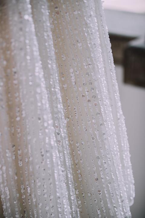 biele popolnočné svadobné šaty s flitrami